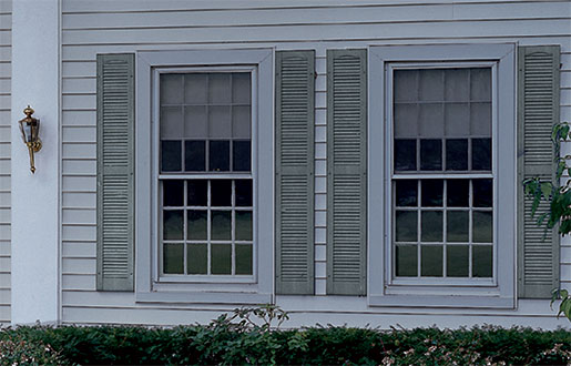 Close up of House with Alcoa Louvered Vinyl Shutters in Custom Shutter Sizes