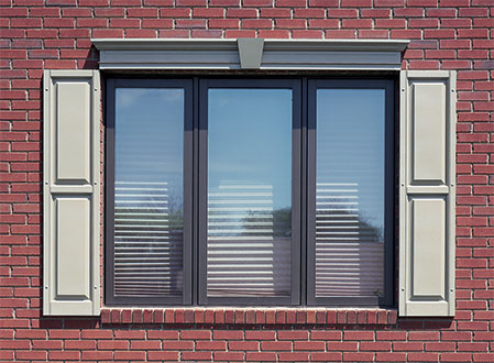 Raised Panel Exterior Shutters on a Brick House
