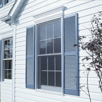 Alcoa Vintage Vinyl Louvered Shutters Installed on Window