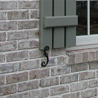 Shutter Tiebacks Pictured on a Brick House