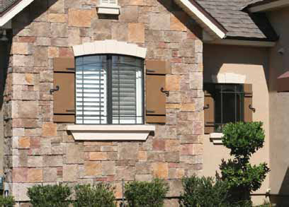 Faux Stone House with Closed Board and Batten Exterior Shutters