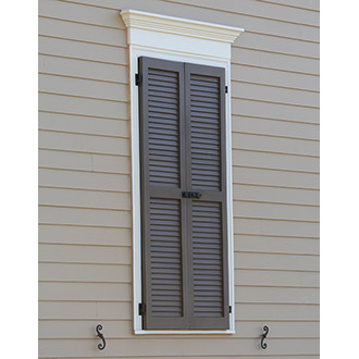 Louvered Shutters Closed Over Window
